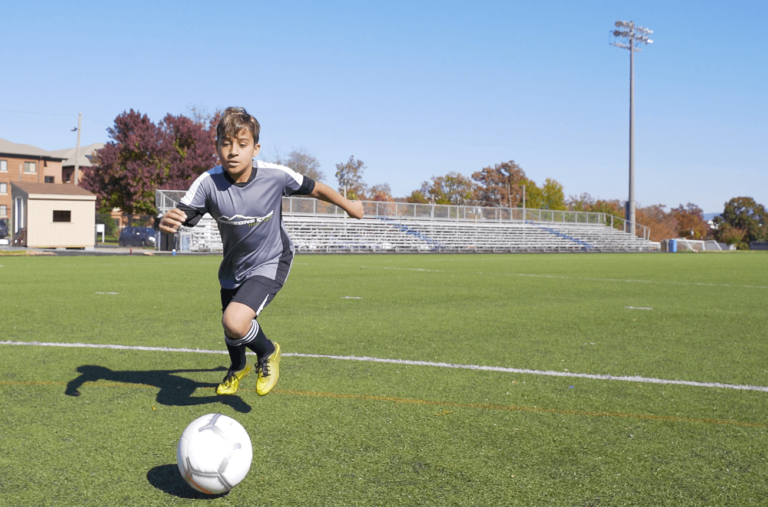 Kid soccer player on the field
